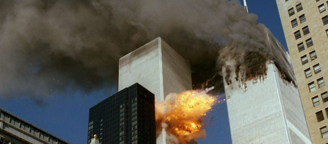 FILE - In this Sept. 11, 2001 file photo, United Airlines Flight 175 collides into the south tower of the World Trade Center in New York as smoke billows from the north tower. (AP Photo/Chao Soi Cheong)/NY403/MANDATORY CREDIT: CHAO SOI CHEONG; SECOND OF A SERIES OF FOUR PHOTOS; TUESDAY, SEPT. 11, 2001 FILE PHOTO; PART OF A PACKAGE OF FILE PHOTOS FOR USE WITH THE ANNIVERSARY OF SEPT. 11, 2001/1108110258