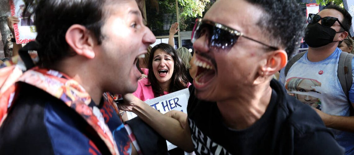 LOS ANGELES, CALIFORNIA - SEPTEMBER 29: #FreeBritney activists react after news that Britney Spears' father, Jamie Spears, was removed by a judge as conservator of her estate at the Stanley Mosk Courthouse on September 29, 2021 in Los Angeles, California. Spears was placed in a conservatorship managed by her father, Jamie Spears, and an attorney, which controls her assets and business dealings, following her involuntary hospitalization for mental care in 2008. Spears and her father have asked the court to remove him from his role in the conservatorship.   Kevin Winter/Getty Images/AFP (Photo by KEVIN WINTER / GETTY IMAGES NORTH AMERICA / Getty Images via AFP)